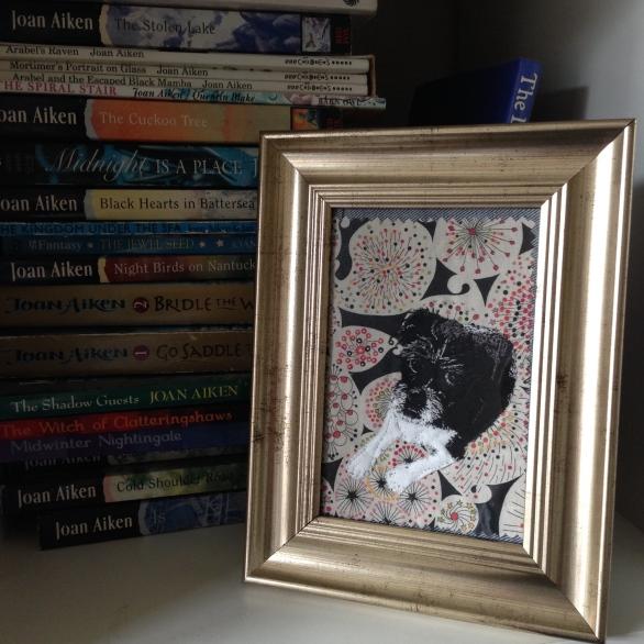 Bella on bookcase