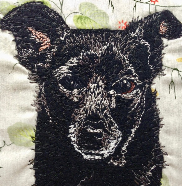 Cole in closeup: Freestyle machine embroidery, bespoke portraits